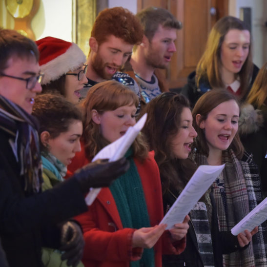 Listen to Christmas choirs at Restoration Yard