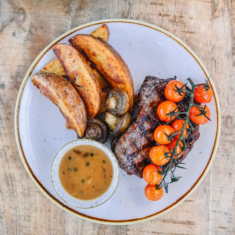 Steak served in The Kitchen at Restoration Yard