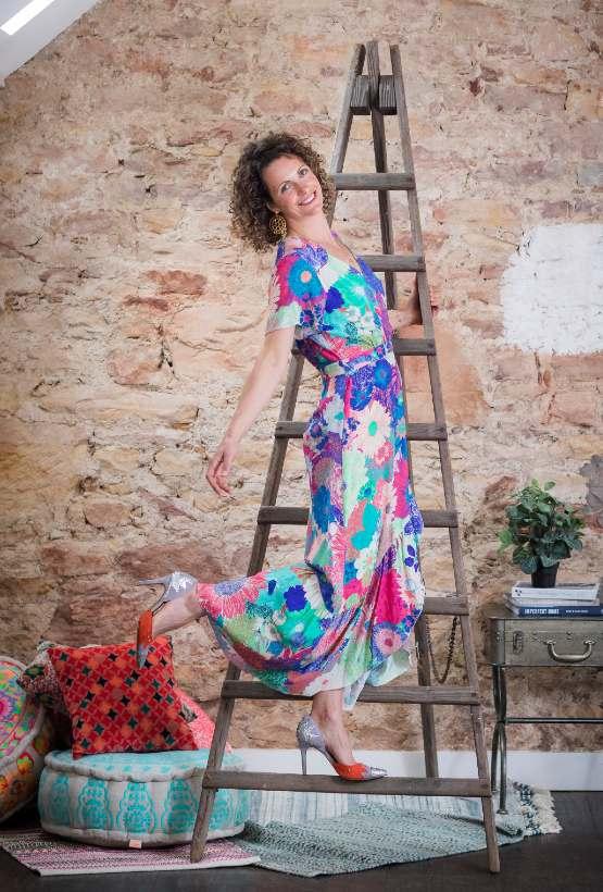 Vilagallo Myrna Floral Dress Model on step ladder