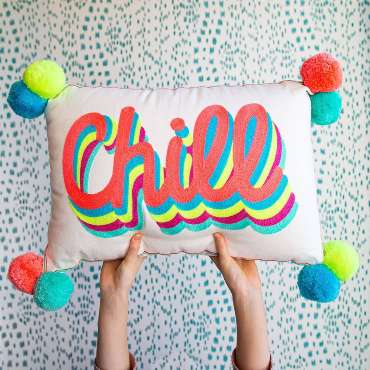 Bombay Duck Chill Cushion hands holding it up new in homeware